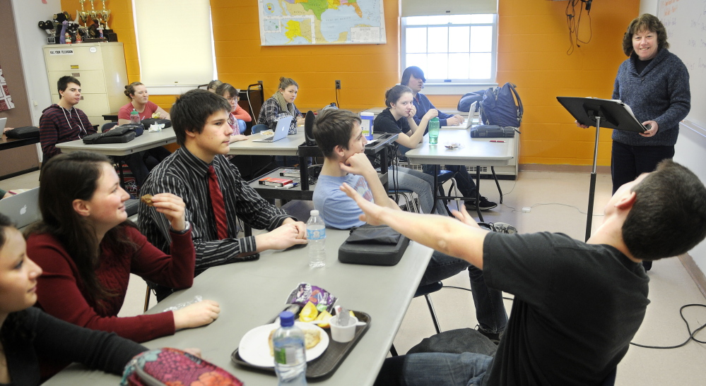 CONDITIONING: Teacher Cathy Foyt challenges members of Monmouth Academy's Academic Decathon team to learn the history portion for the annual contest between schools during a practice at the Monmouth school.