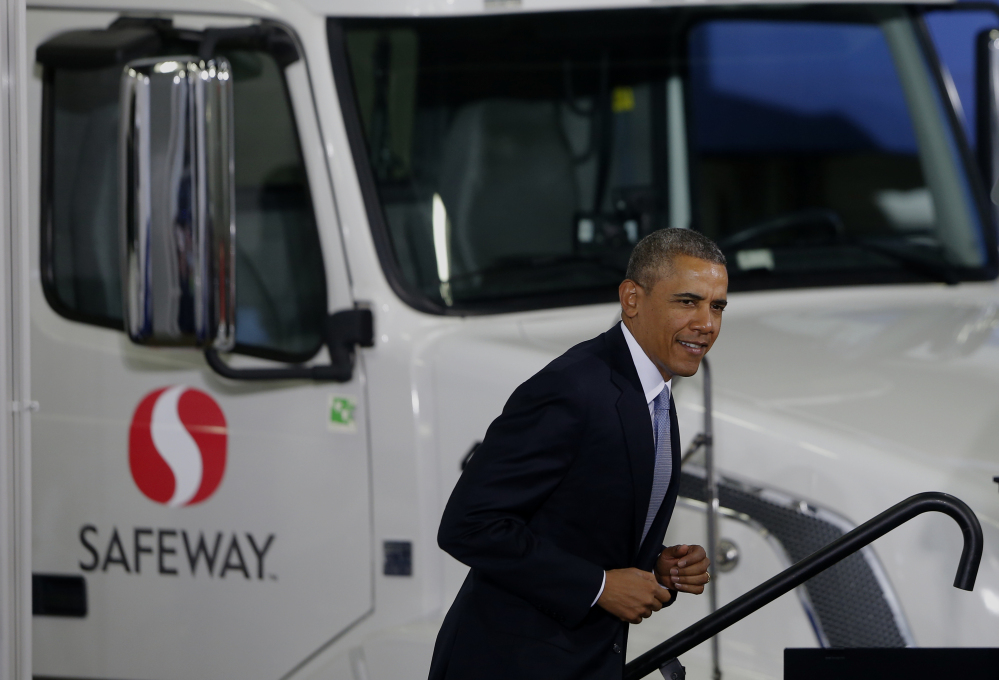 President Barack Obama arrives to speak at a distribution center for Safeway stores in Upper Marlboro, Md., on Tuesday. In addition to calling for tougher fuel efficiency standards for trucks, Obama was to renew his call for Congress to end billions of dollars in federal subsidies to oil and natural gas companies.