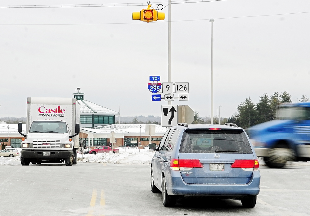 CRASH-PRONE: Drivers entering and leaving the West Gardiner Service Plaza wait for a break in traffic on Route 9 and 126, which doesn't stop at the intersection, on Tuesday in West Gardiner. The Maine Department of Transportation is proposing a roundabout there.