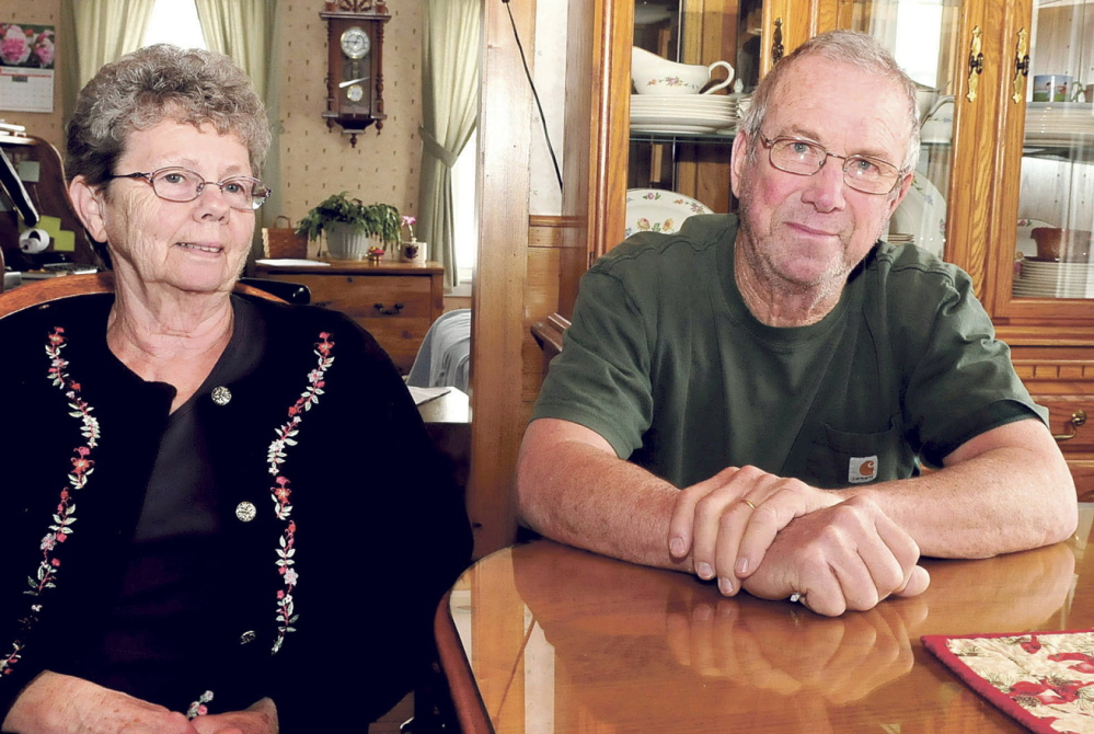 TOP FARMERS: Connie and Elroy Chartrand speak on Tuesday at their Norridgewock dairy farm about being named Producer of the Year by the Oakhurst Dairy company.