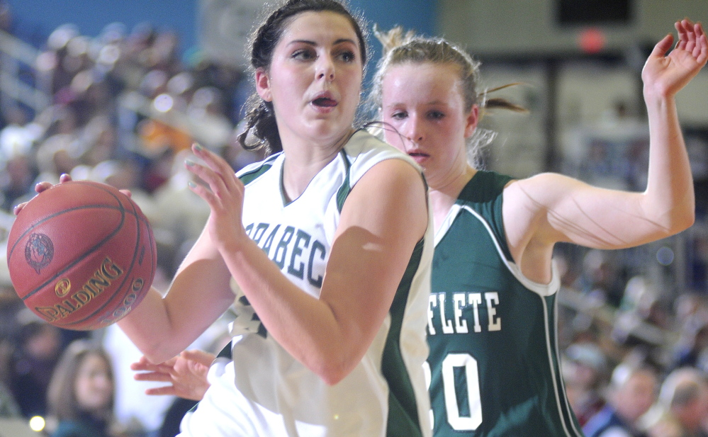 Staff photo by Andy Molloy Carrabec High School's Mickayla Willette, left, dribbles around Waynflete School's Arianna Giguere during a basketball match up Tuesday in Augusta.