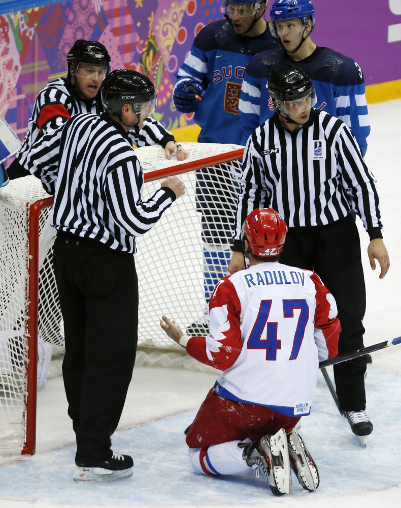 Russia forward Alexander Radulov appeals to officials after trying to score on Finland goaltender Tuukka Rask in the third period of a men's quarterfinal ice hockey game at the 2014 Winter Olympics, Wednesday, Feb. 19, 2014, in Sochi, Russia.