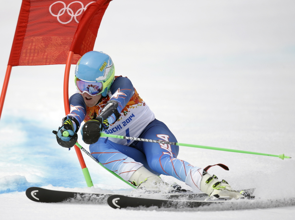 Ted Ligety passes a gate in the first run of the men's giant slalom at the 2014 Winter Olympics Wednesday.