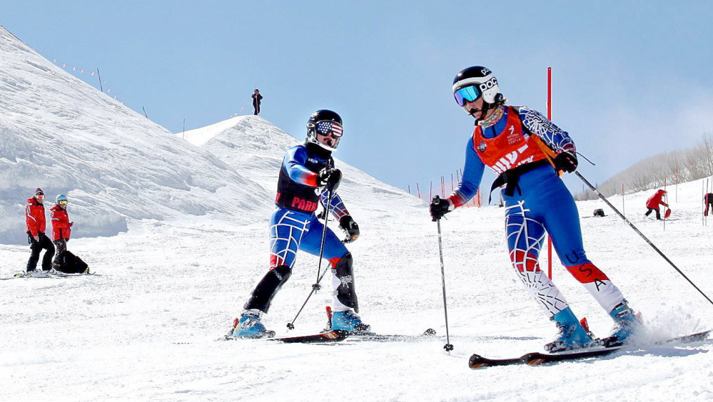 BLIND SKIER: Lindsay Ball, left, of Benton, trains with ski guide Diane Barras recently while preparing to compete in the Paralympics in Sochi in March.