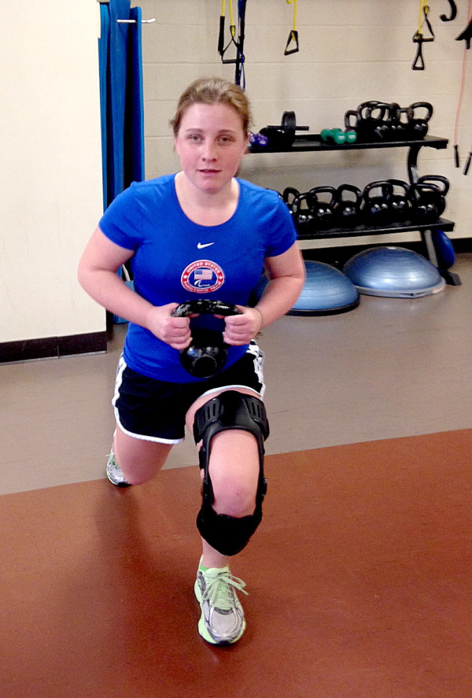THERAPY: Lindsay Ball of Benton performs physical therapy to prepare for ski racing in Sochi in March. In January, Ball fell down while skiing and tore her ACL, requiring four weeks of intense physical therapy to give her a chance to compete.