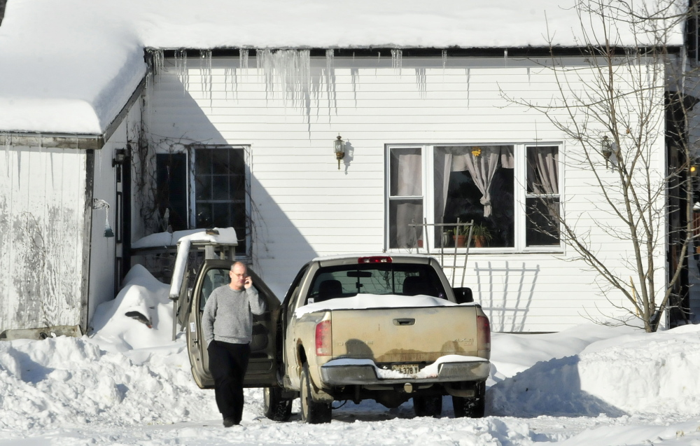 SHOOTING SCENE: Clinton police officer Rusty Bell investigates the scene on the Horseback Road in Clinton on Jan. 5. Police said Edward Domasinsky attempted to shoot his girlfriend, missed, and then attempted suicide by shooting himself in the face.