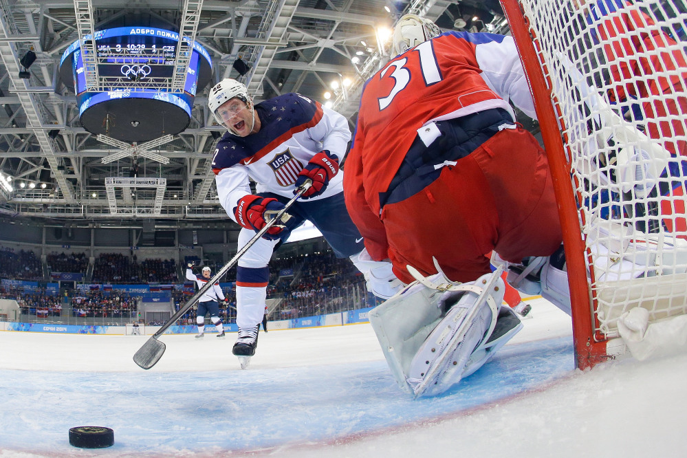 IT'S GOOD: United States forward David Backes celebrates as forward Zach Parise's shot gets by Czech Republic goaltender Ondrej Pavelec during the second period of men's quarterfinal game Wednesday in Shayba Arena at the 2014 Winter Olympics in Sochi, Russia.