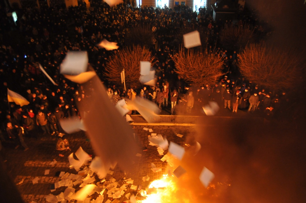 Ukrainian protesters throw out and burn papers from prosecutor's headquarters in Lviv, western Ukraine, early Wednesday.
