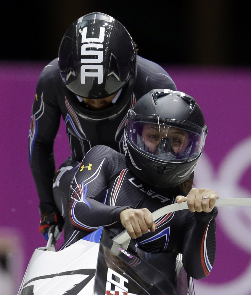 The team from the United States USA-1, piloted by Elana Meyers with brakeman Lauryn Williams, start their third run during the women's bobsled competition at the 2014 Winter Olympics, Wednesday, Feb. 19, 2014, in Krasnaya Polyana, Russia.