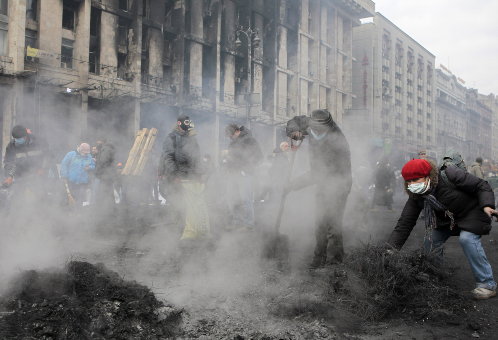 Activists reinforce the barricades in Kiev's Independence Square, the epicenter of the country's current unrest, Thursday.