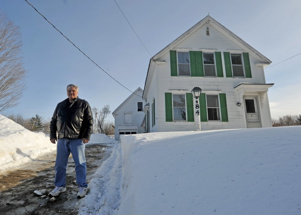 NEW SHELTER: The Rev. Richard Berry stands on Thursday outside a newly acquired home that will be used as a shelter for families at Trinity Evangelical Free Church in Skowhegan.