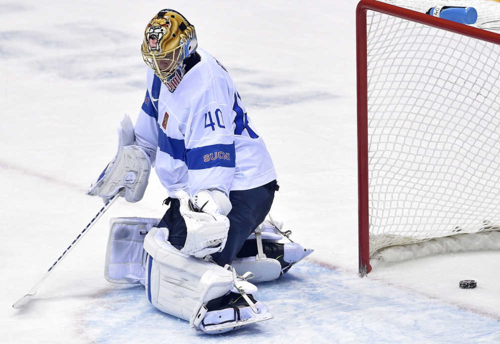 A shot by Canada defenseman Drew Doughty gets by Finland goalie Tuukka Rask (40) for the winning goal during overtime in a men's ice hockey game at the Winter Olympics Sunday, Feb. 16.