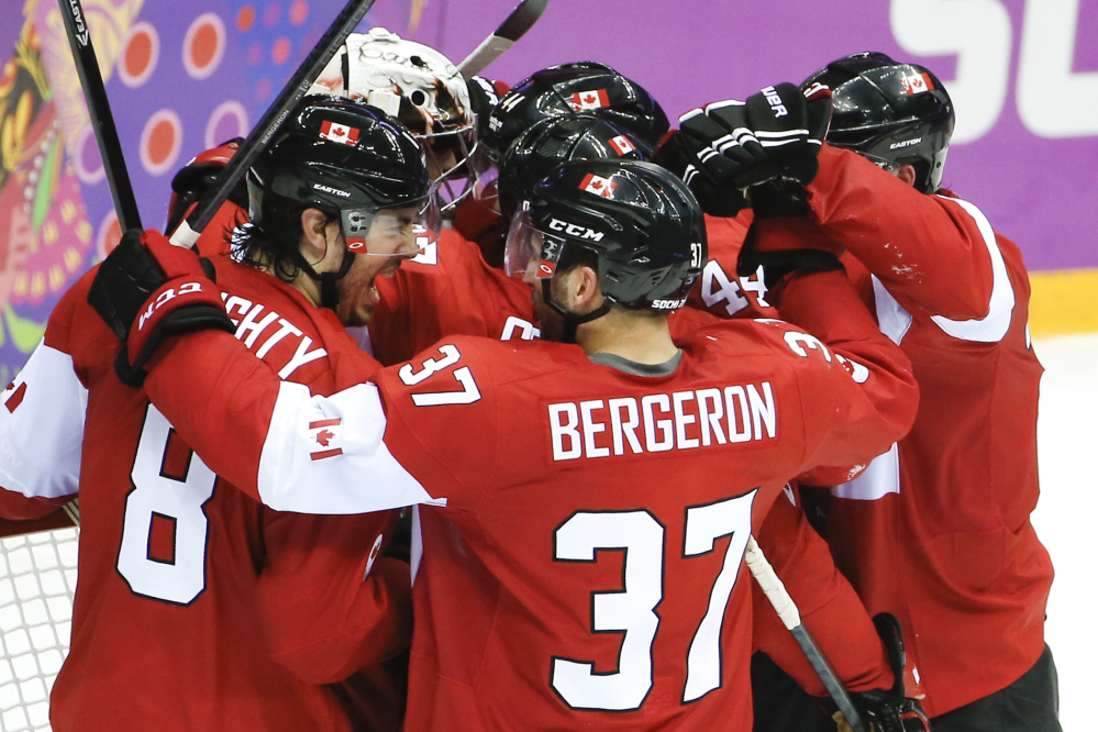 Team Canada celebrates its 1-0 victory over the United States in the men's semifinal ice hockey game at the 2014 Winter Olympics on Friday in Sochi, Russia.
