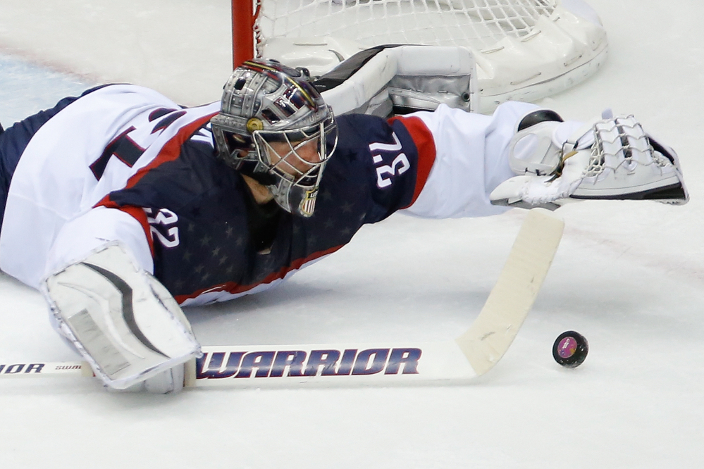 American goaltender Jonathan Quick dives for the puck during the second period of the men's semifinal ice hockey game at the 2014 Winter Olympics on Friday in Sochi, Russia.