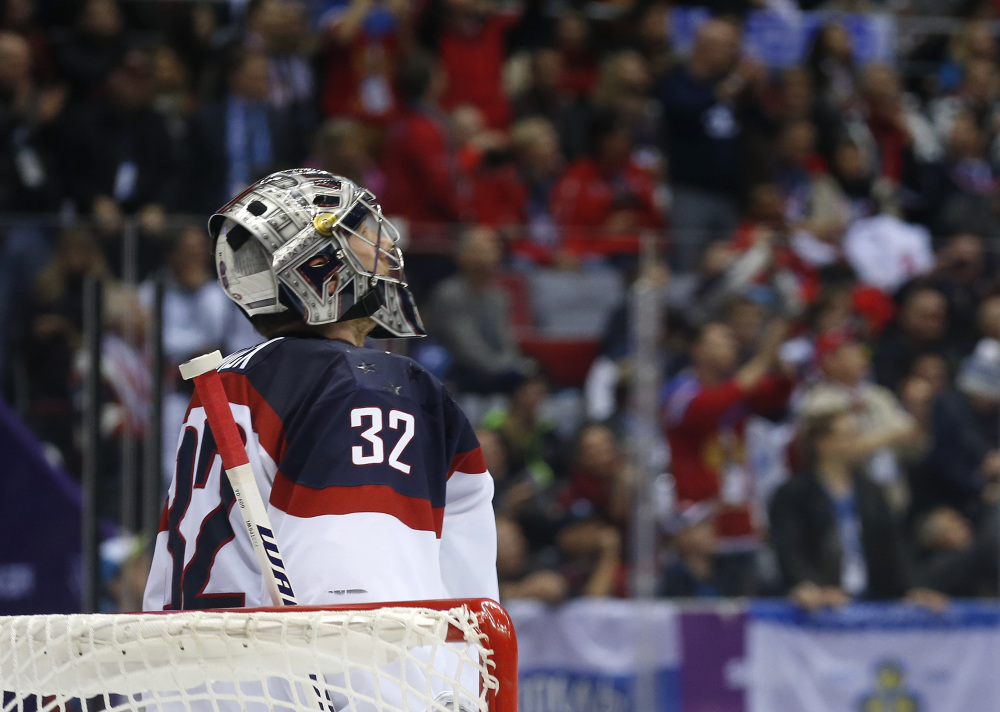 American goaltender Jonathan Quick reacts after Canada scored a goal during the second period of a men's semifinal ice hockey game at the 2014 Winter Olympics on Friday in Sochi, Russia.