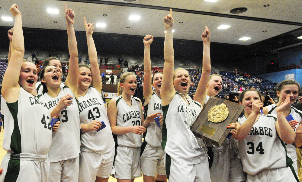Celebrate good times: Carrabec Cobras celebrate after winning the Class C West girls championship game over Madison on Saturday February 22, 2014 at Augusta Civic Center.