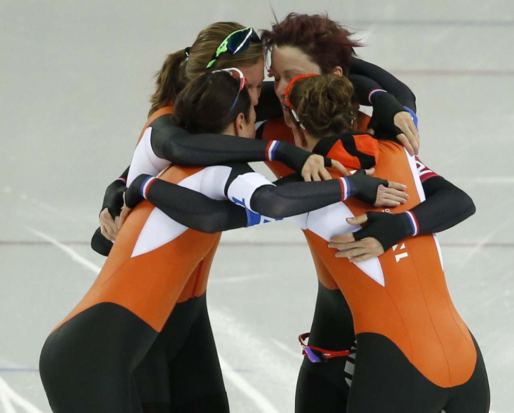 Speedskaters from the Netherlands celebrate taking the gold medal on the women's team pursuit Saturday at the Adler Arena Skating Center at the 2014 Winter Olympics in Sochi, Russia.