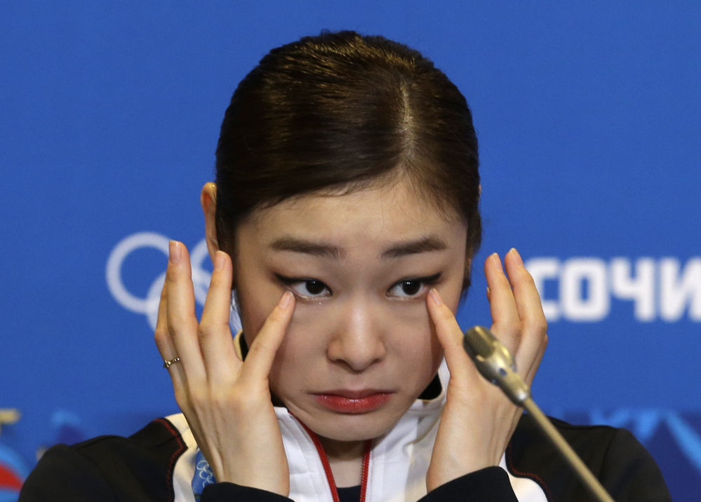 Yuna Kim of South Korea wipes her face as she attends a news conference following the women's free skate figure skating finals at the Iceberg Skating Palace during the 2014 Winter Olympics on Thursday in Sochi, Russia.