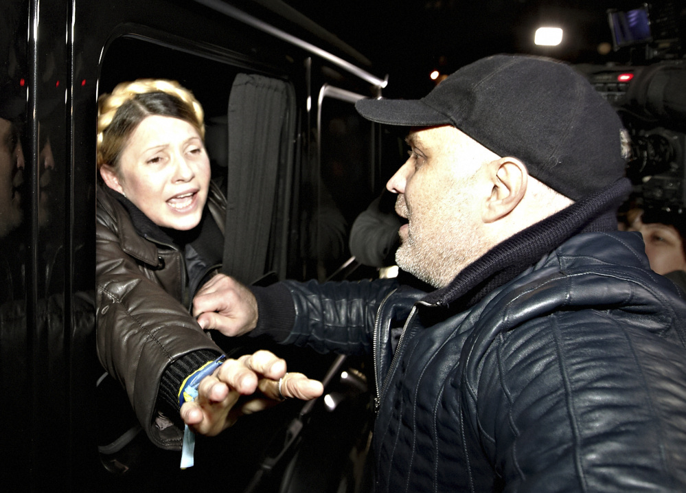 Former Ukrainian Prime Minister Yulia Tymoshenko is greeted by supporters shortly after being freed from prison in Kharkiv, Ukraine, on Saturday. One of her close allies said Tymoshenko was traveling directly to address the crowds on Kiev's iconic Independence Square – occupied since President Yanukovych's decision in November to spurn an agreement with the European Union in favor of closer ties with Russia.