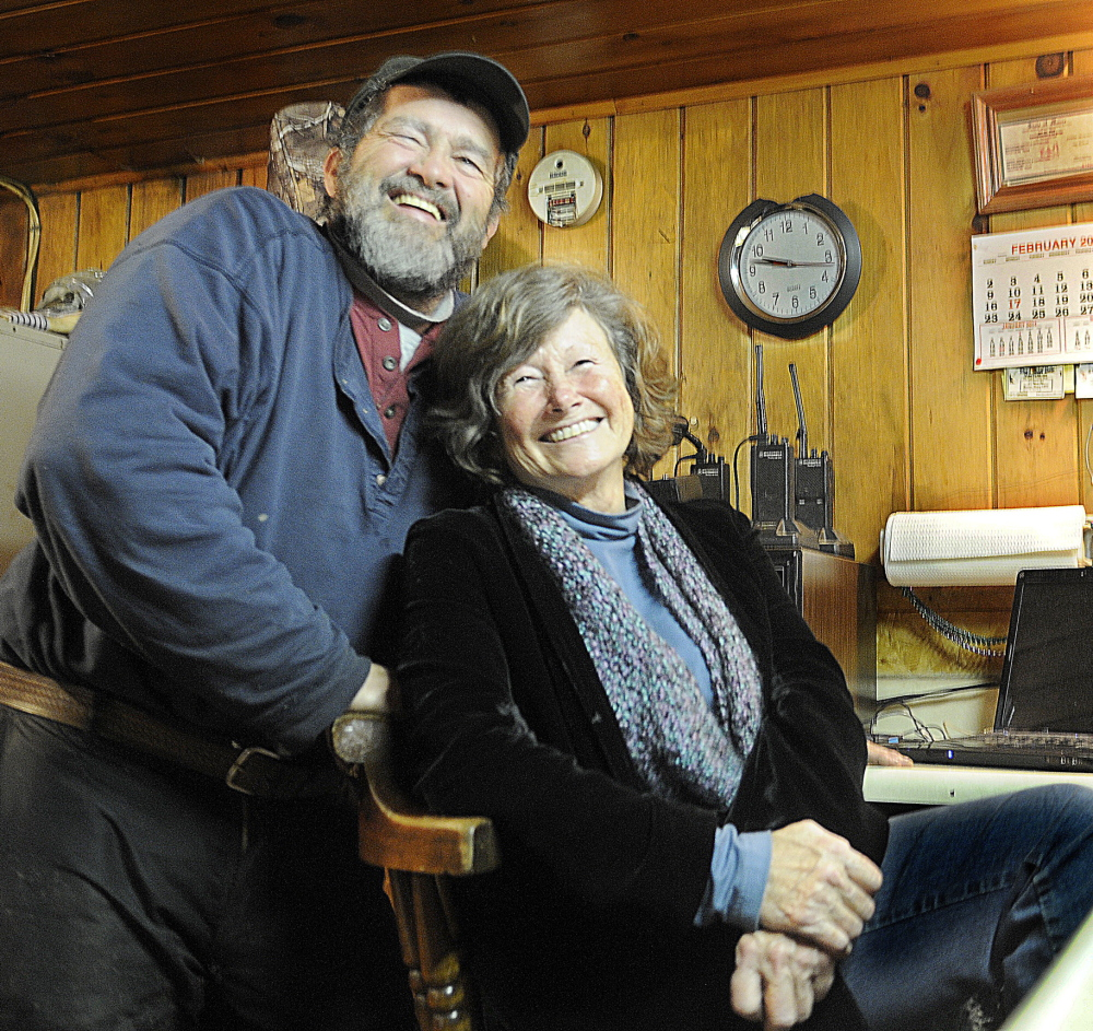 CUT BAIT: Mike Baker and his partner Cindy Lougee wait on a customer Wednesday at Baker's Smelt Camps in Pittston. Baker's is closing early this year because of a lack of rainbow smelt in the Kennebec River.