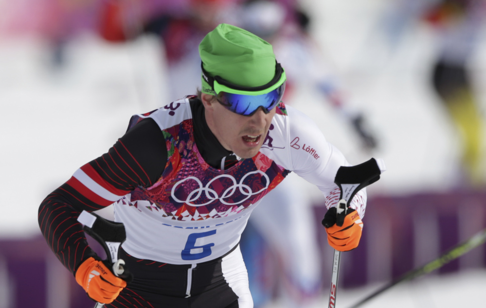 Austria's Johannes Duerr competes during the men's cross-country 30k skiathlon Feb. 9 at the 2014 Winter Olympics in Krasnaya Polyana, Russia. Duerr has been kicked out of the Sochi Games after testing positive for EPO, the country's Olympic committee said Sunday.