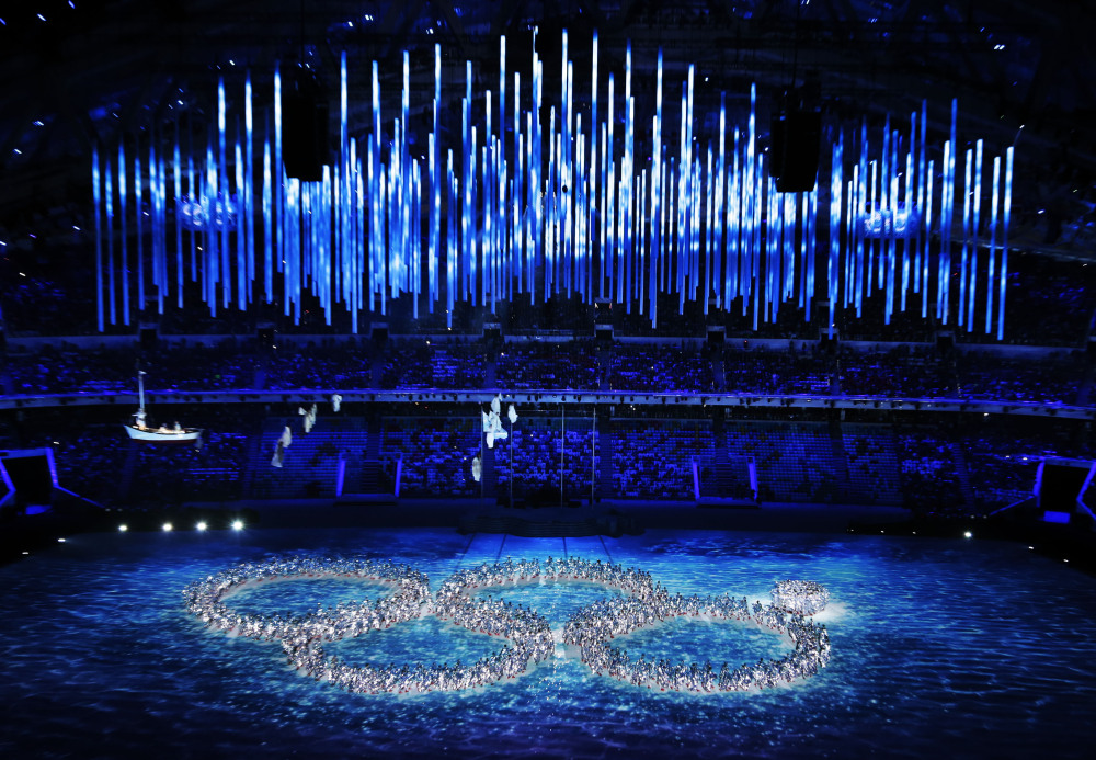 Performers recreate the ring that did not open during the opening ceremony during the closing ceremony of the 2014 Winter Olympics on Sunday in Sochi, Russia.