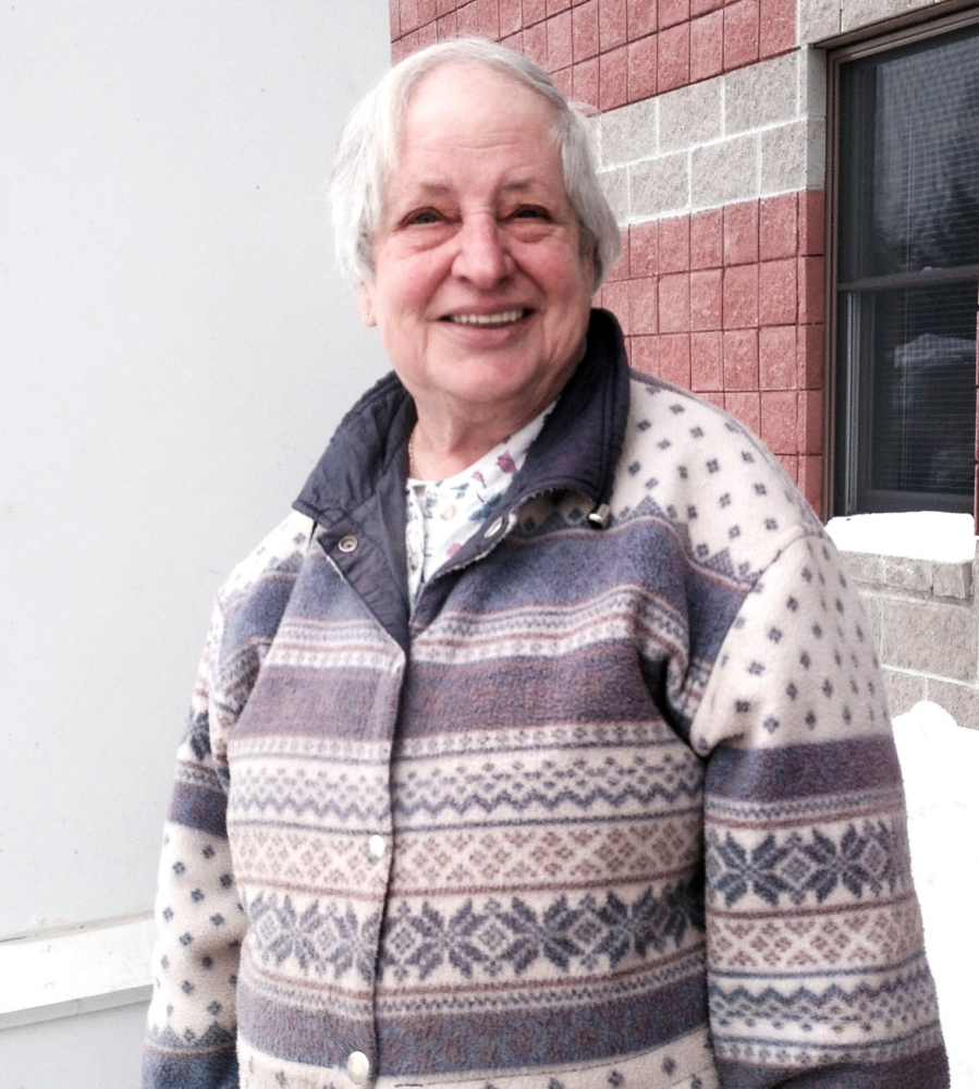 NO DEMISE YET: Shirley Beaver stands outside the U.S. Social Security office in Waterville.