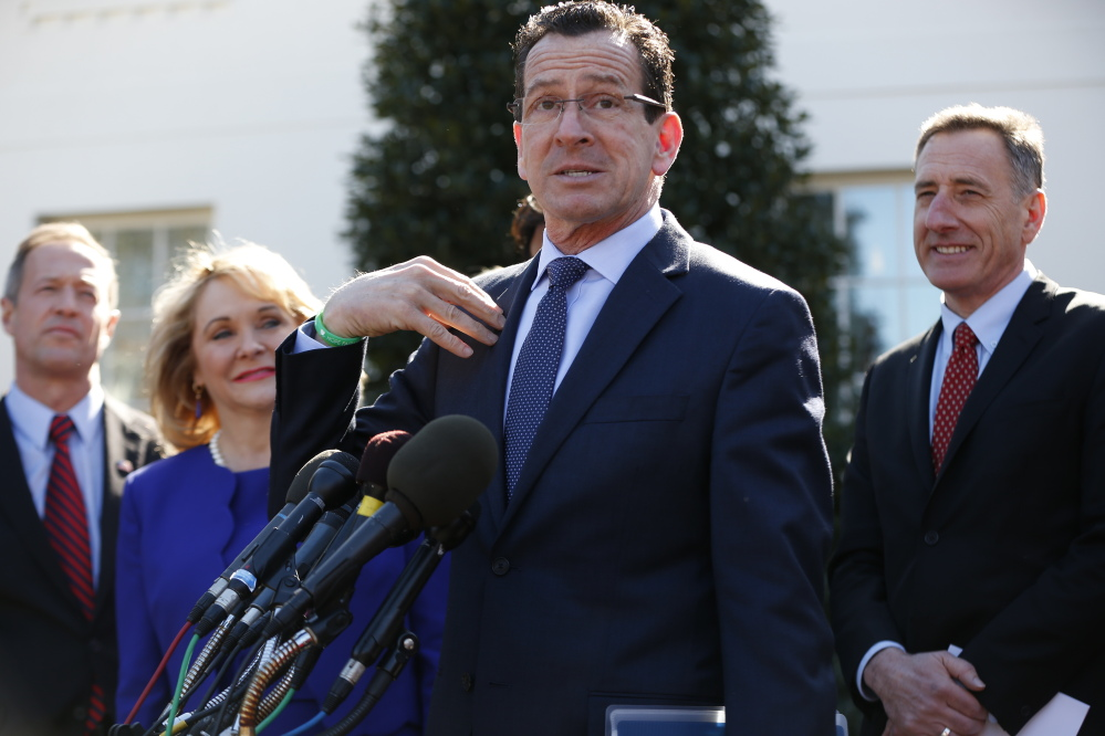 Connecticut Gov. Dannel Malloy, center, speaks to reporters outside the White House in Washington on Monday following a meeting between President Barack Obama and members of the National Governors Association. From left are, Maryland Gov. Martin O'Malley, Oklahoma Gov. Mary Fallin, Malloy, and Vermont Gov. Peter Shumlin.