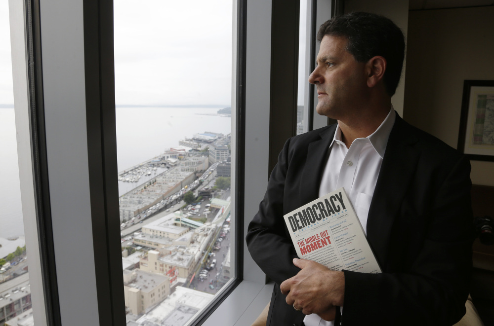 """Venture capitalist Nick Hanauer holds a copy of """"Democracy: A Journal of Ideas,"""" which includes an article he co-authored promoting an economy driven by a strong middle class."""