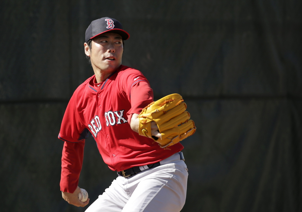 Boston Red Sox relief pitcher Koji Uehara winds up for a throw in the bullpen during spring training baseball practice on Feb. 20 in Fort Myers, Fla.