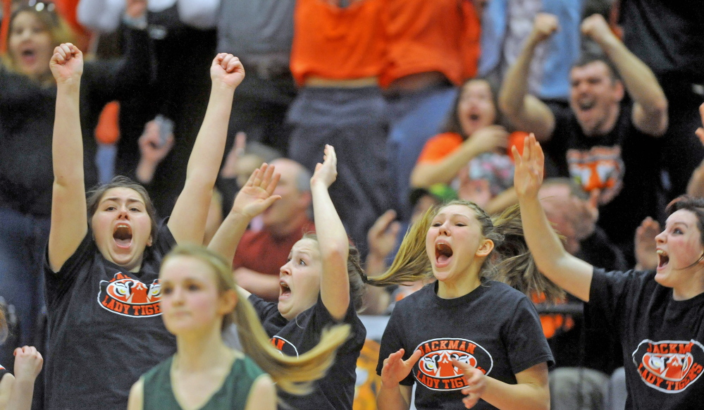 Staff file photo by Michael G. Seamans The Forest Hills High School girls basketball team celebrate their 53-52 win over Rangely last Saturday in Augusta. Kori Coro's buzzer-beating three-pointer sealed victory for the undefeated Tigers.
