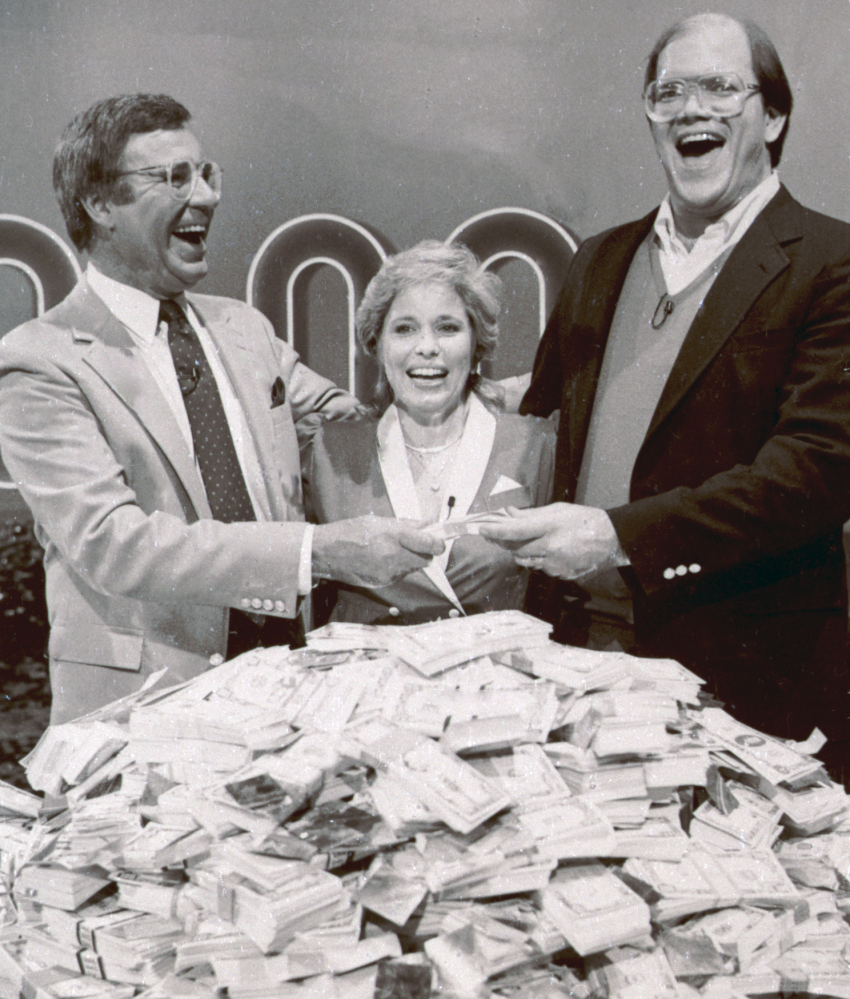 """This 1986 photo shows host Jim Lange, left, congratulating Connie and Steve Rutenbar of Mission Viejo, Calif., after they won $1 million on the TV show """"The $1,000,000 Chance of a Lifetime."""""""