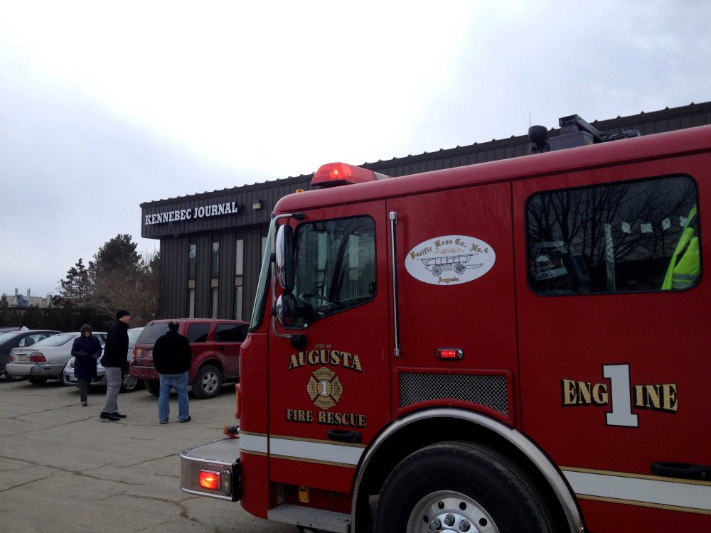 Evacuation: Augusta Fire Department ladder trucks attend the scene of an evacuation prompted by a strong smell of gas at the Kennebec Journal offices Thursday. Maine Natural Gas said the smell came from a routine line flushing earlier in the day.