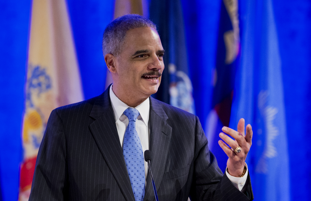 Attorney General Eric Holder speaks at the annual Attorneys General Winter Meeting in Washington on Tuesday.