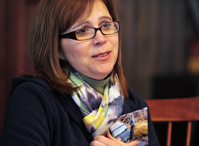 Theresa Allocca, mother of Tim Davison, who was shot in Pennsylvania, recounts the details of her son's shooting and the investigation Wednesday as she holds a photo of her son taken last summer at a camp near Turner. Wednesday, February 19, 2014. Gordon Chibroski, Staff Photographer