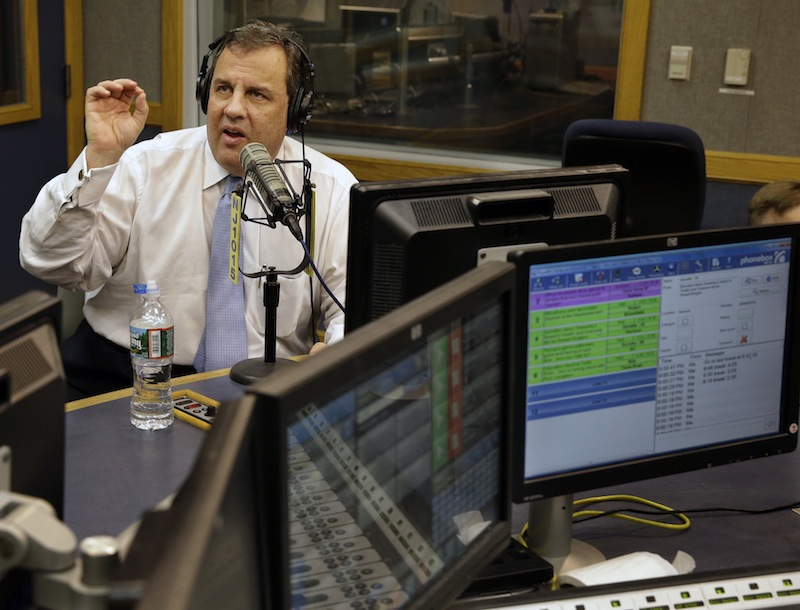 """New Jersey Gov. Chris Christie sits in a studio during his radio program, """"Ask the Governor"""" broadcast on NJ 101.5, Monday, Feb. 3, 2014, in Ewing, N.J. During the program, Christie took questions from callers for the first time in more than three weeks as his campaign looked for a way to pay for lawyers as a political payback scandal continues."""