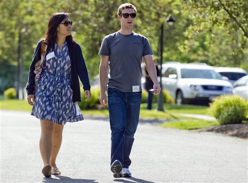 Mark Zuckerberg, president and CEO of Facebook, walks with Priscilla Chan in Sun Valley, Idaho in this 2011 file photo. The Chronicle of Philanthropy says the couple donated 18 million Facebook shares, valued at more than $970 million, to a Silicon Valley nonprofit in December.