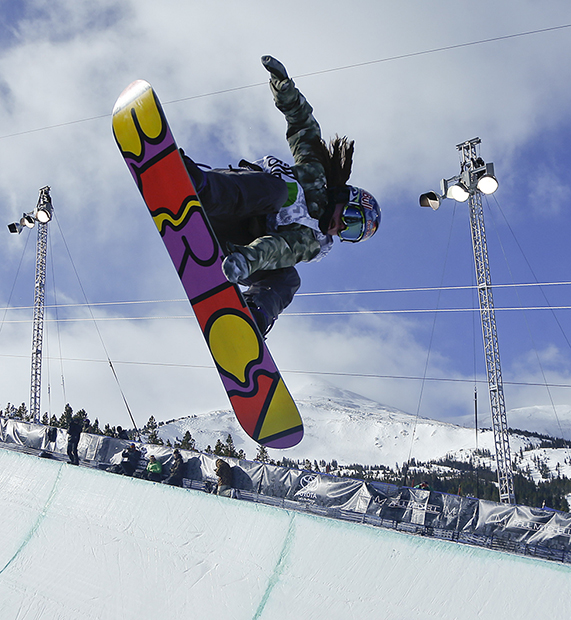 FILE - In this Dec. 14, 2013, file photo, Arielle Gold competes during the snowboarding superpipe final at a Dew Tour event in Breckenridge, Colo. Taylor and Arielle Gold are taking their brother and sister act to Sochi. The Golds are members of the U.S. Olympic halfpipe snowboarding team that is expected to come home from Russia with multiple medals.