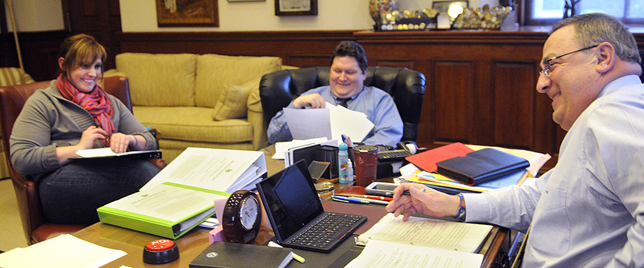 Gov. Paul LePage works on his third State of the State address Monday with his daughter, Lauren LePage, and Chief of Staff John McGough in the governor's office in Augusta. The governor will present the speech Tuesday during a joint session of the Legislature. Lauren LePage serves as an adviser on the governor's re-election campaign.