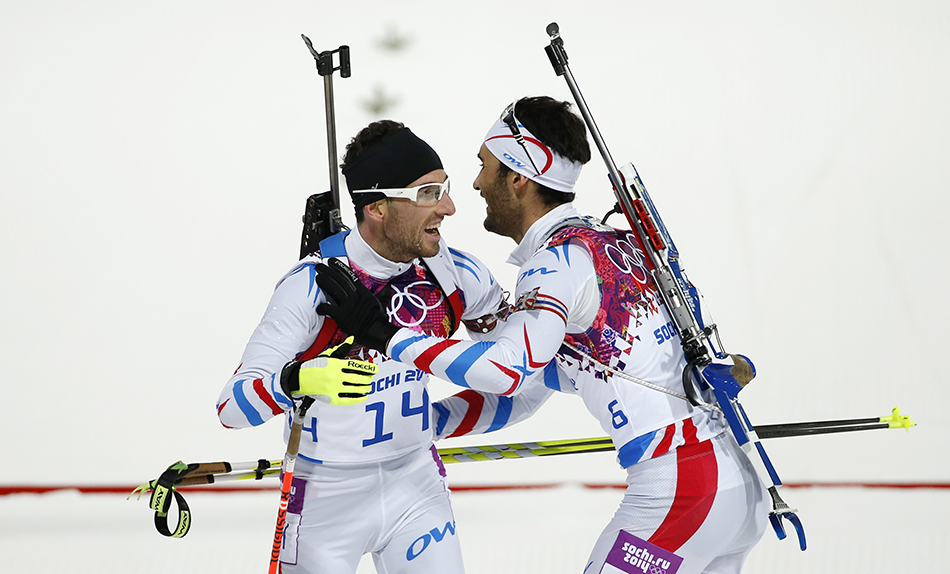France's gold medal winner Martin Fourcade, right, hugs his teammate bronze medal winner Jean Guillaume Beatrix after the men's biathlon 12.5k pursuit, at the 2014 Winter Olympics, Monday, Feb. 10, 2014, in Krasnaya Polyana, Russia. (AP Photo/Felipe Dana) 2014 Sochi Olympic Games;Winter Olympic games;Olympic games;Spor