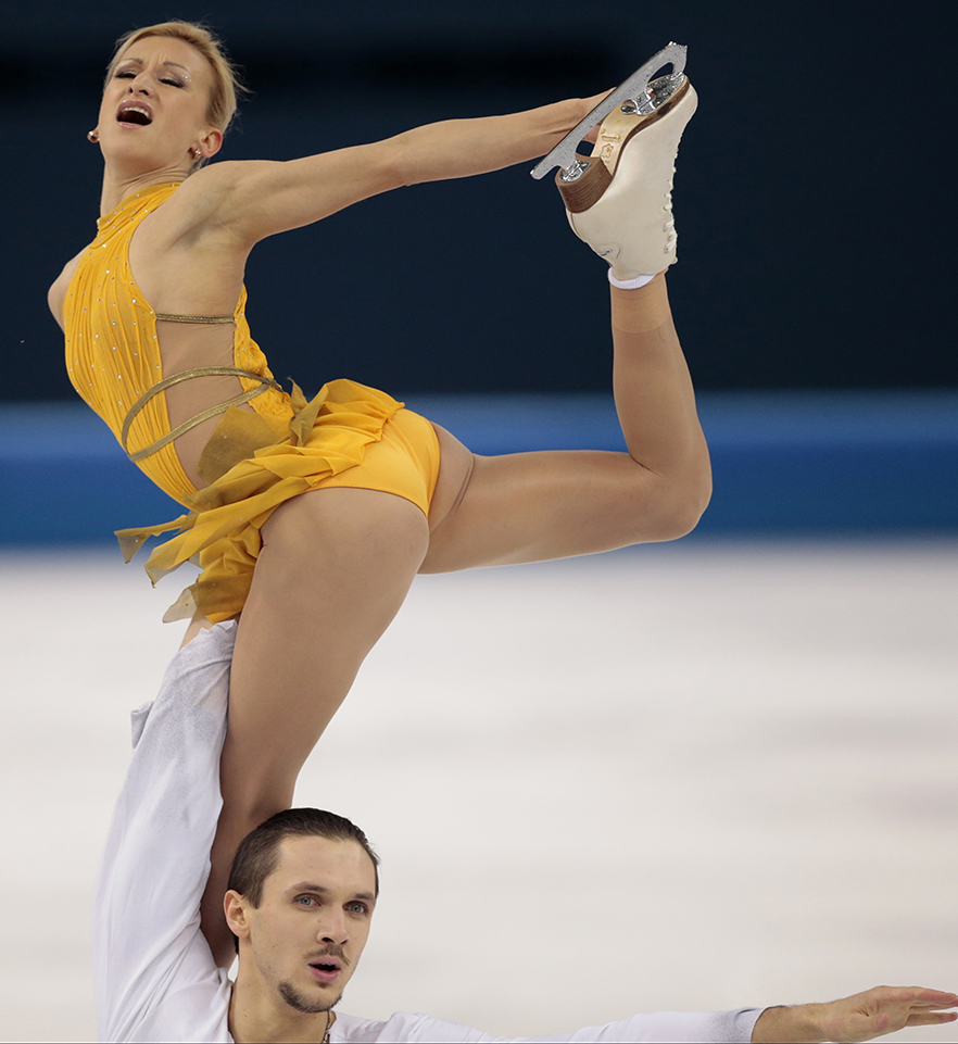 Tatiana Volosozhar and Maxim Trankov of Russia compete in the pairs free skate figure skating competition at the Iceberg Skating Palace during the 2014 Winter Olympics, Wednesday, Feb. 12, 2014, in Sochi, Russia.