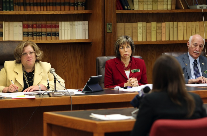 Members of the Senate Judiciary Committee, from left, Chair Sharon Carson, Bette Lasky, and Sam Cataldo listen to a rape victim during a hearing at the Statehouse in Concord, N.H. Tuesday Feb. 4, 2014. Lawmakers are considering a bill to terminate a parent's rights to a child if the child was conceived as a result of rape and the parent is convicted of the sexual assault.