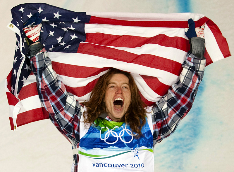 """FILE - In this Feb. 17, 2010, file photo, Shaun White, of the United States, celebrates his gold medal in the men's snowboard halfpipe finals at Cypress Mountain in West Vancouver, Brtish Columbia, at the 2010 Vancouver Olympic Winter Games. White heads to the Sochi winter Olympics as arguably the most famous athlete competing: """"It's going to push me to do things I never would've done before,"""" he says."""
