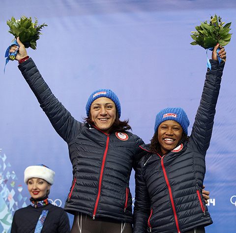 Silver medal winners from the United States Elana Meyers and Lauryn Williams, pose during the flower ceremony during the women's bobsled competition at the 2014 Winter Olympics, Wednesday, Feb. 19, 2014, in Krasnaya Polyana, Russia. (AP Photo/Michael Sohn) 2014 Sochi Olympic Games;Winter Olympic games;Olympic games;Spor
