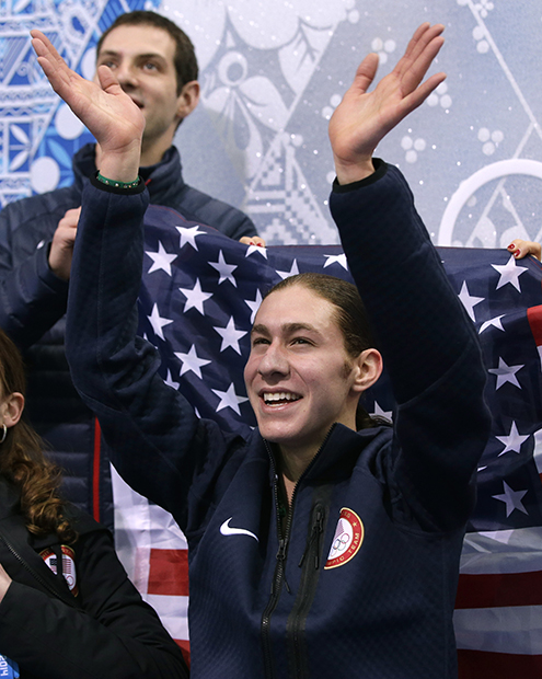 Jason Brown of the United States waves to spectators as he waits for his results after competing in the men's team free skate figure skating competition at the Iceberg Skating Palace during the 2014 Winter Olympics, Sunday, Feb. 9, 2014, in Sochi, Russia.