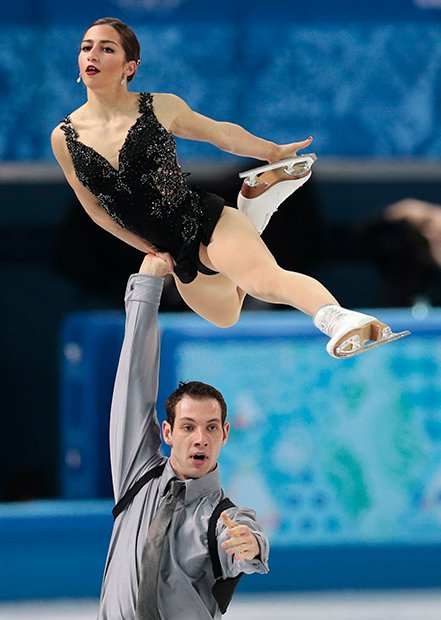 Marissa Castelli and Simon Shnapir of the United States compete in the team pairs free skate figure skating competition at the Iceberg Skating Palace during the 2014 Winter Olympics, Saturday, Feb. 8, 2014, in Sochi, Russia.