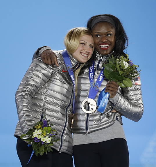 Women's bobsleigh bronze medalists Jamie Greubel, left, and Aja Evans of the United States embrace one another during their medals ceremony at the 2014 Winter Olympics, Thursday, Feb. 20, 2014, in Sochi, Russia. (AP Photo/David Goldman) 2014 Sochi Olympic Games;Winter Olympic games;Olympic games;Spor