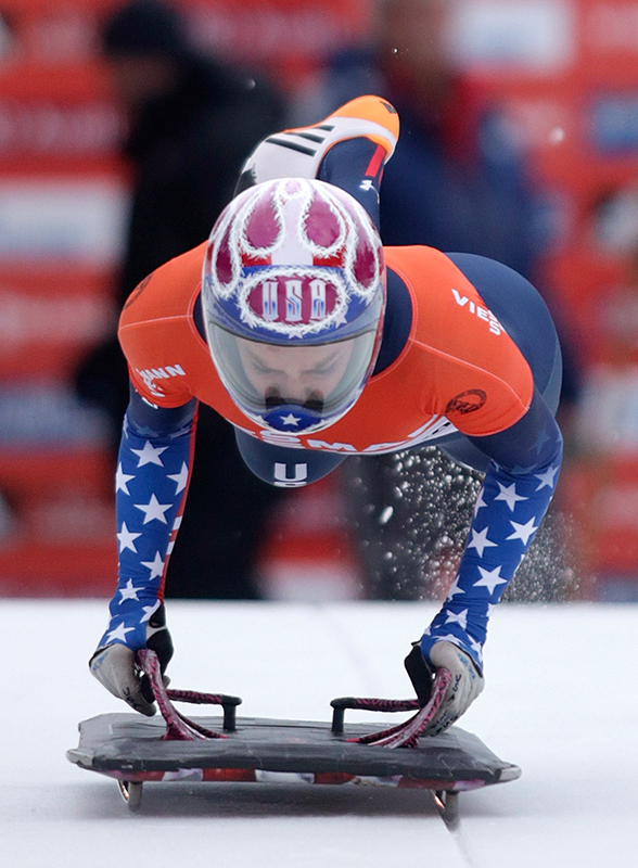 Winner Noelle Pikus-Pace of the U.S. jumps on her sledge during the women's Skeleton World Cup in St. Moritz, Switzerland, on Saturday, January 11, 2014.