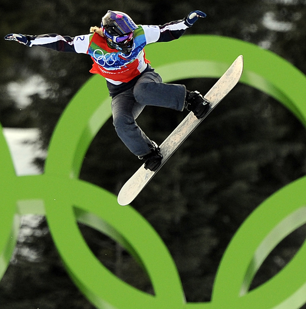 In this Feb. 16, 2010, photo, Lindsey Jacobellis, of the United States, competes during the quarterfinals of the women's snowboardcross at the Vancouver 2010 Olympics in West Vancouver, British Columbia. Gold medals in snowboardcross at the Winter X Games on Friday, Jan. 24, 2014, went to a pair of familiar: Jacobellis and Nate Holland. The perfect way to head over to Sochi, where both will be on the U.S. Olympic team.