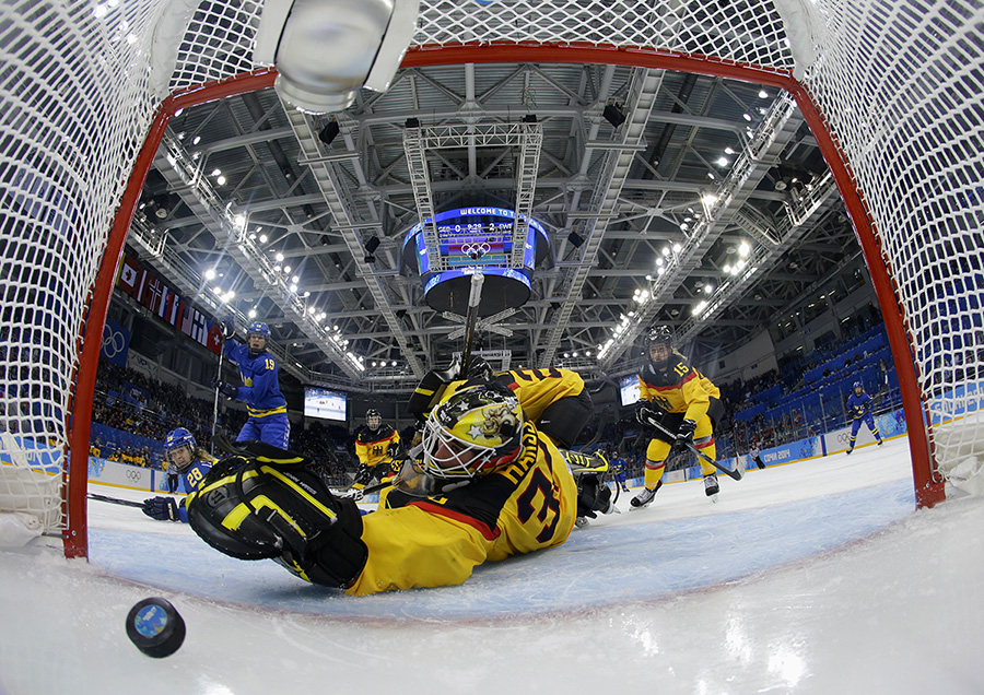 Germany's goalie Jennifer Harss watches the puck enter the net on a goal by Sweden's Johanna Olofsson (not seen) during the third period of their women's preliminary round hockey game at the Sochi 2014 Winter Olympic Games February 11, 2014.